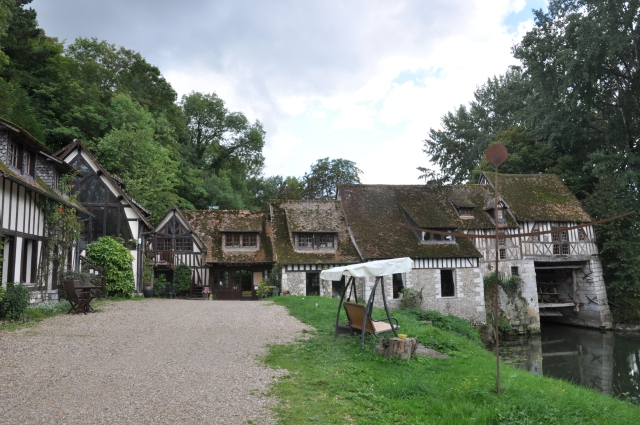 "The old writers' colony at ""Le Moulin d'Andé"" in Normandy, as it looks today, with its mill pond."
